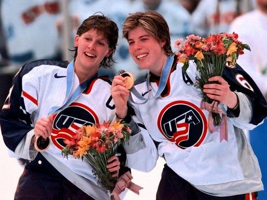 U.S. Olympic women's hockey teammates Cammi Granato, left, and Karyn Bye show their gold medals.