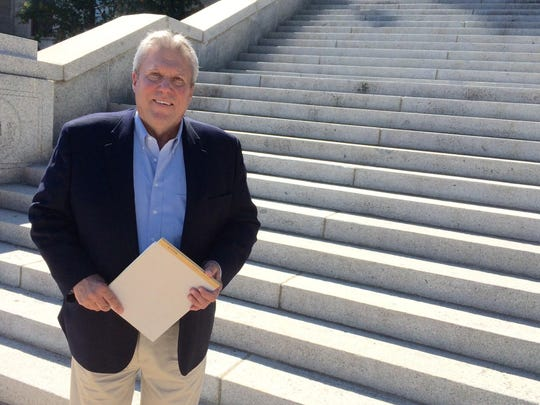 Rep. Jeff Essmann, R-Billings, head of the Montana GOP, is shown in front of the state Capitol on Aug. 2.