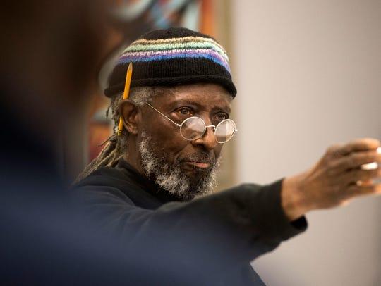 Knoxville resident Zimbabwe U. Matavou speaks during