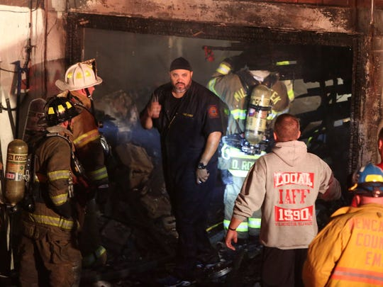 Firefighters work at a rowhome fire on Lakeview Road