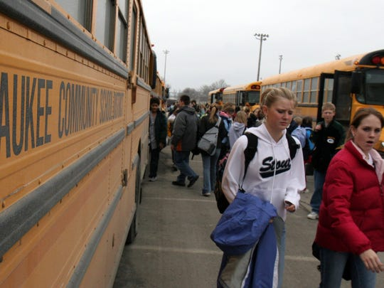 Students from the Waukee Middle School look for their bus for the ride home after school on Wednesday January 26, 2005.
