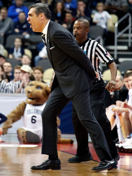 Villanova head coach Jay Wright yells instructions during the first half against Alabama in an NCAA men's college basketball tournament second-round game in Pittsburgh, Saturday, March 17, 2018. Villanova won 81-58. (AP Photo/Gene J. Puskar)