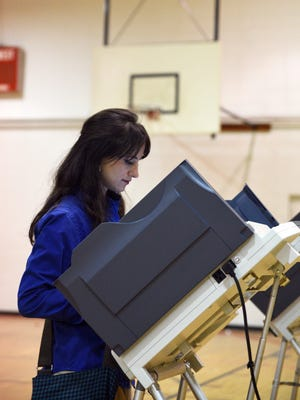 Sydney Taylor of Hattiesburg votes in the party runoff elections at Thames School.