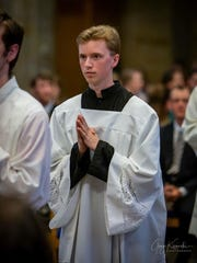 Alex Kalscheur is an altar server at his church, Our Lady of the Greenwood.
