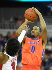 University of Evansville's Ryan Taylor (0) shoots over
