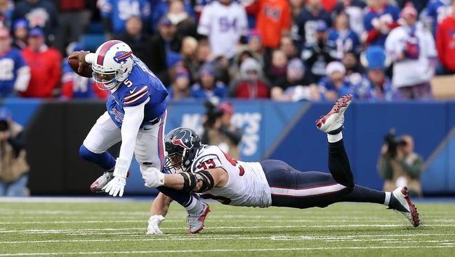 Texan's J.J. Watt pressures Bills quarterback Tyrod Taylor in a 30-21 Buffalo win.