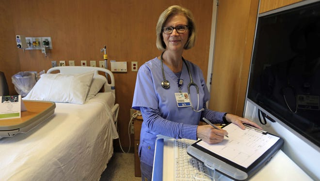 St. Nicholas Hospital Medical Surgical Registered Nurse Carol Gust poses in a patient room in Sheboygan.