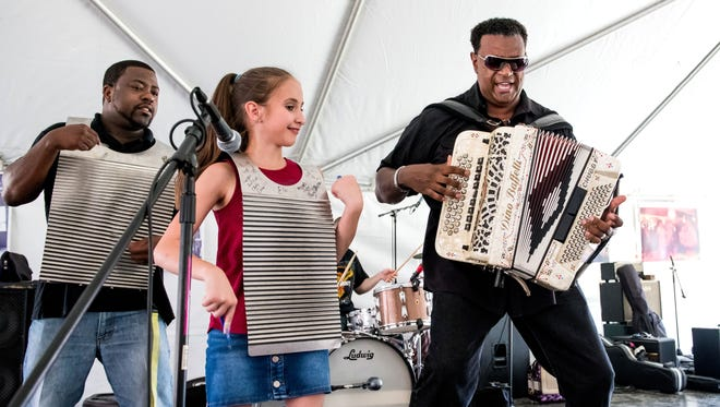 Grammy winner Chubby Carrier, right, plays with Neal Williams, left, and Lexy Broussard at the 2017 Festivals Acadiens et Creole.