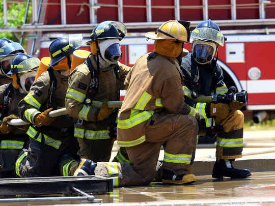 Cadets from the Del Mar College Regional Fire Academy prepare to extinguish a LPG tank during a training exercise Tuesday, July 31, 2017, at Del Mar College-West Campus in Corpus Christi.