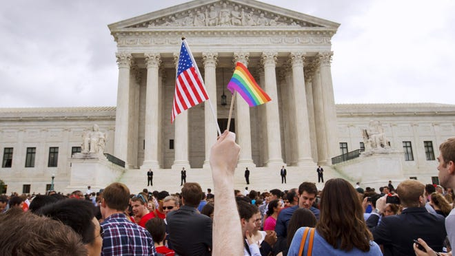 Flags fly outside the Supreme Court after the court legalized gay marriage nationwide.