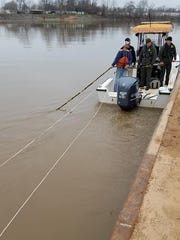 Divers began diving Saturday morning to retrieve the