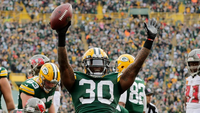 Green Bay Packers running back Jamaal Williams (30) celebrates after scoring a touchdown against the Tampa Bay Buccaneers in the second quarter at Lambeau Field.