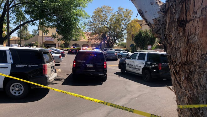 Police on the scene at an officer-involved shooting near El Mirage and Bell roads.