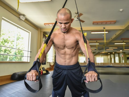 Luis Blanco shows various exercises with his TRX system