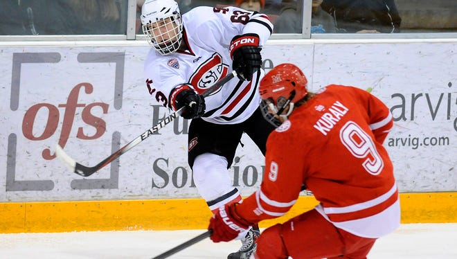 St. Cloud State's Patrick Russell gets a pass past Sean Kuraly of Miami (Ohio) during the first period last season at the Herb Brooks National Hockey Center in St. Cloud. The two teams open NCHC play Friday and Saturday at the Brooks Center.