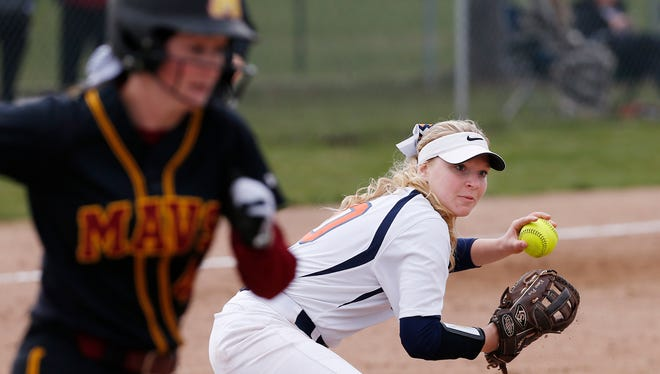 Olivia Stansbury of Harrison fields a infield ground ball by Abby Morland of McCutcheon, but can't throw her out at first in the bottom of the fourth inning Tuesday, April 10, 2018, at McCutcheon High School. Harrison defeated county rival McCutcheon 7-5.