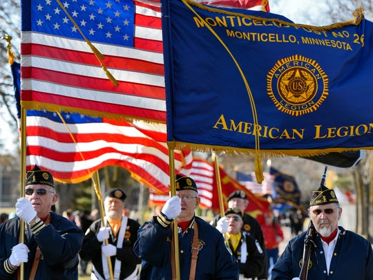 A color guard from the Monticello American Legion Post 260 marches in Sunday's Veterans Day Parade at the St. Cloud VA Health System grounds.