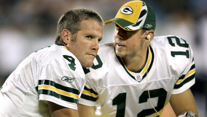 Green Bay Packers quarterbacks Brett Favre, left, and Aaron Rodgers during an Oct. 3, 2005 game against the Carolina Panthers in Charlotte, N.C.