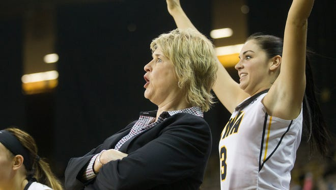 Iowa head coach Lisa Bluder and Claire Till watch Melissa Dixon sink a 3-pointer during the Hawkeyes' win against Northwestern at Carver-Hawkeye Arena on Wednesday. The Hawkeyes look to move to 5-1 in the Big Ten against Michigan State.