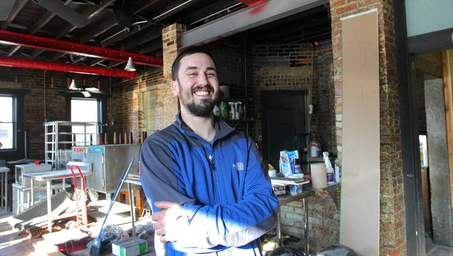 """Doug Knepp poses for a photo at Pop's """"Old and New"""" Bar-B-Q, the former location of The Pit, on Thursday, March 12, 2015."""