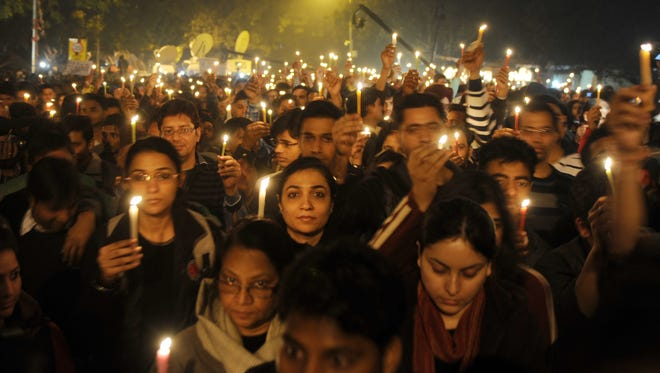 In this photograph taken on Dec. 29, 2012, Indian protesters hold candles during a rally in New Delhi after the death of a gang rape victim from the Indian capital.