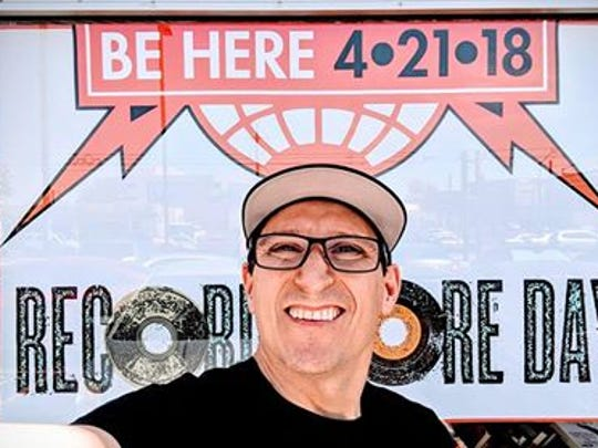 Andrew Boyer in front of a Record Store Day sign