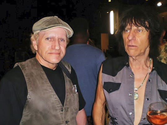 Shippensburg photographer Daryl Bughman, left, photographed with rock performer Jeff Beck.  Photo courtesy Daryl Bughman.
