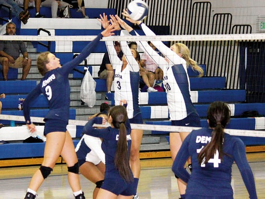 Danny Udero - Silver City Sun-News Photo   Senior Lady Cat hitter Amanda Borden challenged Silver High's tandem block throughout Tuesday's non-district volleyball match at Silver City. The Deming varsity girls lost to their Grant County rivals 3-1;