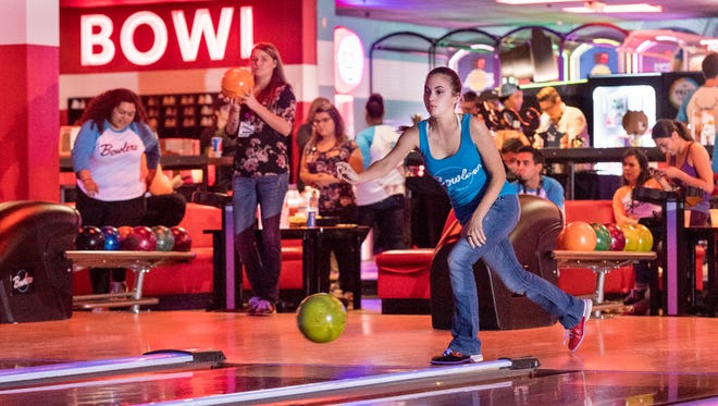 Jewels Jenkins bowls with other employees at the newly refurbished Bowlero in Visalia on Tuesday, September 19, 2017.