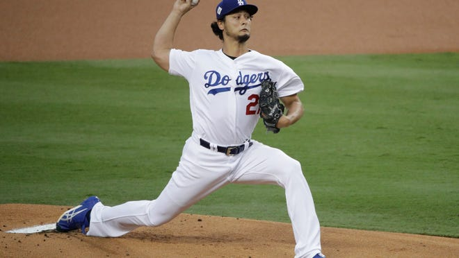 """FILE - In this Nov. 1, 2017, file photo, Los Angeles Dodgers starting pitcher Yu Darvish, of Japan, throws against the Houston Astros during the first inning of Game 7 of baseball's World Series in Los Angeles. Free agent pitcher Darvish said Monday, Dec. 18, he had a """"very good meeting"""" with the Chicago Cubs. Darvish tweeted a statement in Japanese confirming the meeting amid reports that Cubs executives Theo Epstein and Jed Hoyer were in Dallas to speak with the right-hander. (AP Photo/Jae C. Hong, File)"""