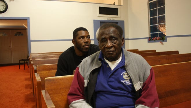 Troy Williams, left, sits with his grandfather James Williams, at Mt. Olive Baptist Church on Wednesday evening. The two men sing with the men's chorus at the church.