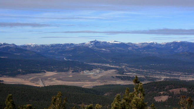 Forested terrain overlooking Martis Valley near Truckee, Calif. A coalition of conservation groups is seeking to block a proposed 760-home development in the area. They filed a lawsuit against Placer County Nov. 10, 2016.