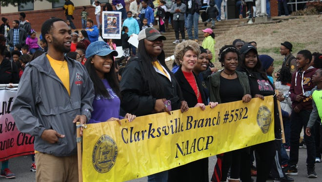 Clarksville Mayor Kim McMillan, center in red, walks with members of the Clarksville NAACP in the Martin Luther King Jr. Day march on Monday.