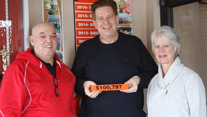 Pictured are, from left: Mark Trepanier, David Boelter, and Patti Trepanier. The Trepaniers have donated more than $100,000 to The Arc Fond du Lac.