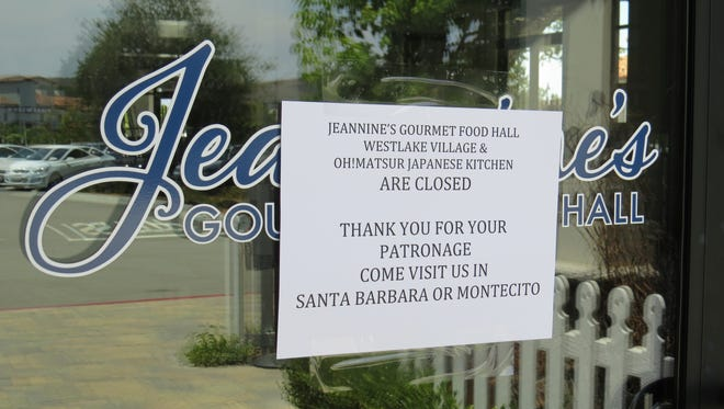 """A """"thank you for your patronage"""" sign greets would-be diners at Jeannine's Gourmet Food Hall, which closed this month in Westlake Village."""