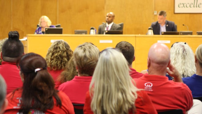 Teachers wearing red shirts came out to the School Board budget hearing on Thursday.