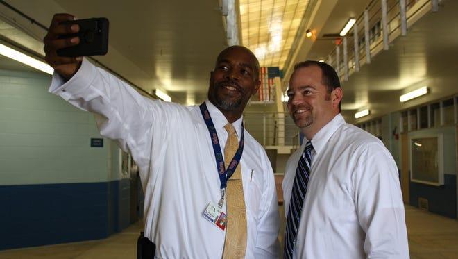 Superintendent Desmond Blackburn takes a selfie with DeLaura Middle School Principal Bobby Pruett.