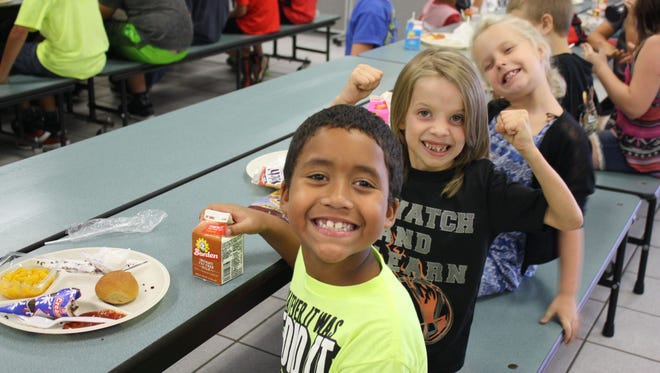 A class at Pinewood Elementary in Mims eats lunch Monday morning, their first day back at schools since Hurricane Irma hit Florida. The school district announced this week that all 74,000 students will get free lunch until Oct. 20.