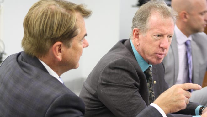 Rep. Thad Altman (left) and school board member Andy Ziegler at a meeting Wednesday to discuss legislative priorities for the next session.