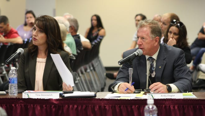 School board members Tina Descovich and Andy Ziegler at a workshop Tuesday to discuss possible school rezoning. The possibility of moving kids from the A-rated Melbourne High to the C-rated Palm Bay High, schools in Ziegler and Descovich's districts respectively, has stirred anger in West Melbourne.