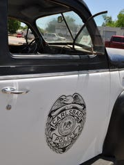 The retired Carlsbad Police Department vehicle still bears the department's shield.
