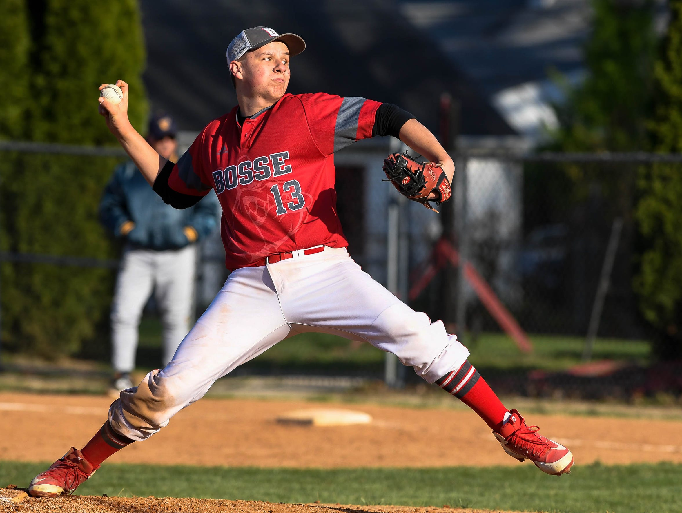 Bosse's starting pitcher Zack Curtis (13) pitches as