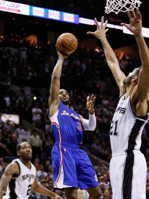 Chris Paul (3) and the Clippers will host Tim Duncan (21) and the Spurs in Game 7 on Saturday.