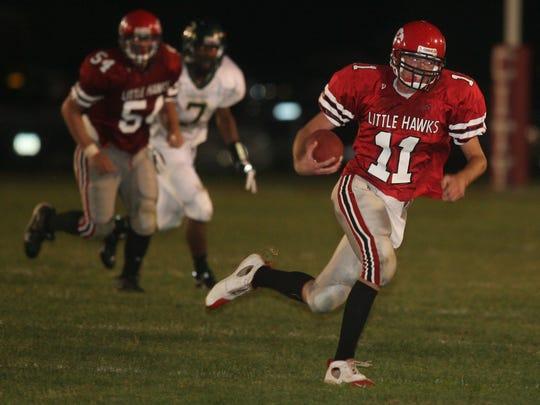 PC Photo by Matthew Holst  City High quarterback Teddy