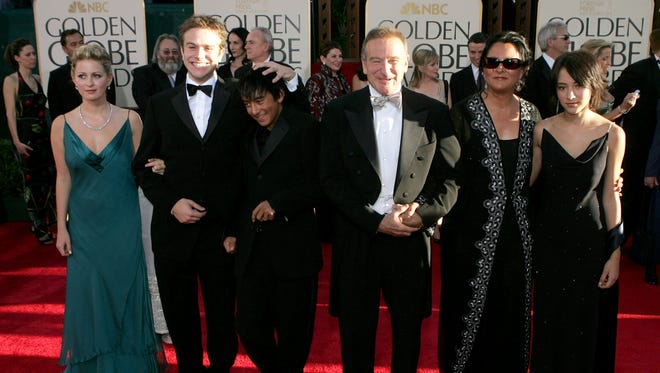 Actor Robin Williams and wife Marsha Garces Williams, sons Cody, Zachary with girlfriend Alex, daughter Zelda arrive at the 62nd Annual Golden Globe Awards at the Beverly Hilton Hotel January 16, 2005 in Beverly Hills, California.