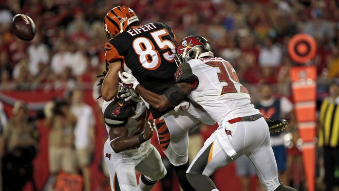 Cincinnati Bengals tight end Tyler Eifert (85) is hit hard as a pass is broken up at the goal line during the second quarter of the NFL pre-season game between the Cincinnati Bengals and the Tampa Bay Buccaneers at Raymond James Stadium in Tampa, Fla., on Monday, Aug. 24, 2015.
