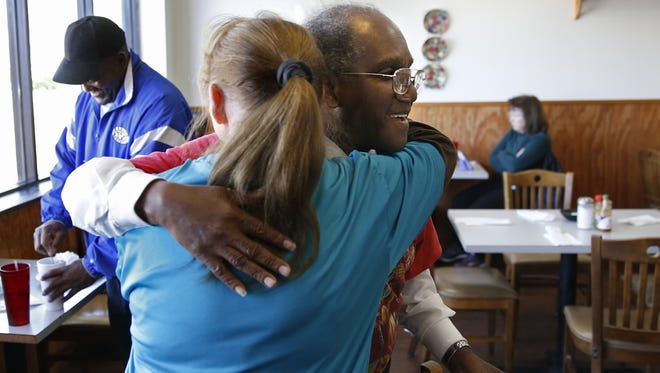 Charles Chislom hugs server Angel Browning goodbye at Savannah's Country Buffet on Gaines Street Tuesday after she gives him a letter from the management explaining why the restaurant is deciding to close the doors to its Gaines street location.