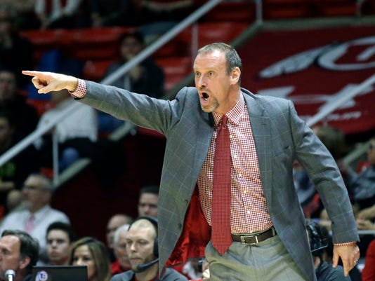 Utah head coach Larry Krystkowiak shouts to his team during the first half in an NCAA college basketball game against Washington State Sunday, Feb. 14, 2016, in Salt Lake City. (AP Photo/Rick Bowmer)