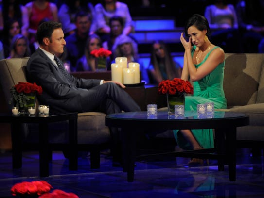 Kelsey wipes away a tear as she and host Chris Harrison