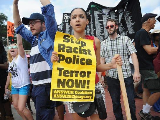 Demonstrators protest outside the Ferguson, Mo., Missouri,